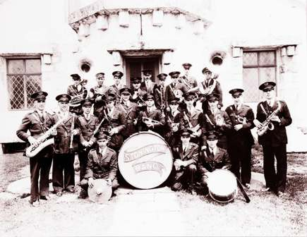 The Stonington Band assembled on the steps of the Old Lighthouse Museum